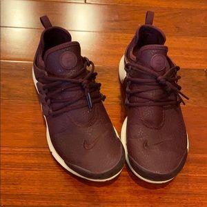 Women's Nike running shoes.